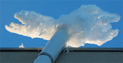 Example of a sub-slab depressurization system with a roof exhaust stack in a cold weather region with ice build-up at the top