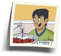 Boy washing strawberries
